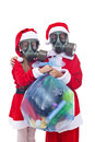 Santa and helper giving you an alternative christmas present wearing gas masks holding bag of used plastic bottles waste isolated Royalty Free Stock Photos