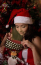 Santa helper looking inside Christmas sock Stock Images