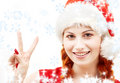 Santa helper showing victory sign with snowflakes Royalty Free Stock Photo