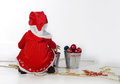 Santa helper sitting toys Royalty Free Stock Photos