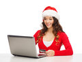 Santa helper woman with laptop and credit card christmas x mas online shopping concept in hat computer Royalty Free Stock Photos