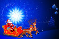 Santa in his sleigh with blue background Stock Image