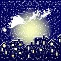 Santa in his sleigh flying över staden Arkivbilder