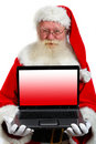 Santa holding a laptop Royalty Free Stock Image