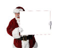 Santa Holding Peeking Around Blank Sign Royalty Free Stock Photo