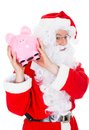 Santa holding piggy bank on white background Stock Images