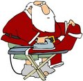 Santa Ironing His Pants Stock Image