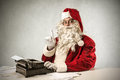Santa klaus having an idea and typing on a typewriter Stock Images