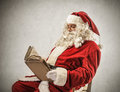 Santa klaus reading a book an old Royalty Free Stock Photo