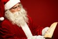 Santa with letter portrait of claus looking at christmas in his hands Stock Images