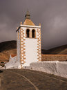 Santa maria church in betancuria fuerteventura of against a stormy sky and mountain backdrop canary islands Stock Photo