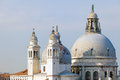 Santa maria della salute in venice an unusual view of the domes and towers of the plague church at the entrance to the grand canal Stock Images