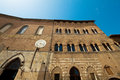 Santa maria della scala siena the facade of the old hospital of in italy now a museum facing the cathedral Royalty Free Stock Photography