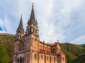 Santa maria la real basilica surrounded by mountains in covadonga asturias Stock Photo