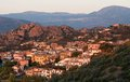 Santa maria navarrese village in sardinia in warm sunrise light italy typical sardinian seascape sardinian village sunrise Stock Photos