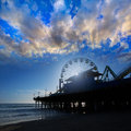 Santa moica pier ferris wheel at sunset in california usa Royalty Free Stock Photo