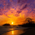 Santa monica california sunset on pier ferrys wheel and reflection beach wet sand Stock Photos