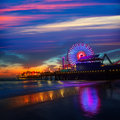Santa monica california sunset on pier ferrys wheel and reflection beach wet sand Royalty Free Stock Images
