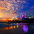 Santa monica california sunset on pier ferrys wheel and reflection beach wet sand Royalty Free Stock Photo