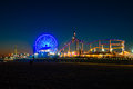 Santa monica pier ferris wheel on lit up at dusk los angeles county california usa Royalty Free Stock Photography
