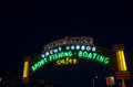 Santa monica pier sign entrance illuminated at night Royalty Free Stock Photography