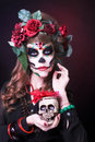 Santa muerte young woman with artistic visage and with roses in her hair Royalty Free Stock Photos