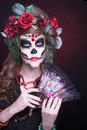 Santa muerte young woman with artistic visage and with roses in her hair Royalty Free Stock Photography