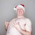 Santa pinching his nipples overweight man in a hat grabbing in pain Royalty Free Stock Photos