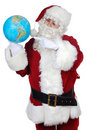 Santa  pointing at a globe Royalty Free Stock Images
