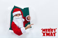 Santa popping out from hole and pointing to copy space claus torne edges Royalty Free Stock Photography