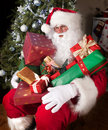 Santa with presents Stock Images
