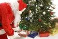 Santa Puts Gifts Under Tree Stock Image