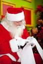 Santa reading a Christmas letter Royalty Free Stock Image