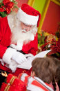 Santa reading to the children Royalty Free Stock Images