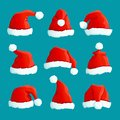 Santa red hats. Christmas funny caps. Santa clothes warm hat. Isolated vector set Royalty Free Stock Photo