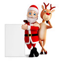 Santa and reindeer for christmas with sign board Stock Photos