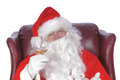 Santa resting enjoying a rest after a nights work with a small libation Royalty Free Stock Images