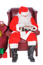 Santa resting enjoying a rest after a nights work with a small libation Royalty Free Stock Photos
