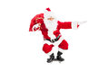 Santa riding a skateboard and holding bag full of presents isolated on white background Stock Image