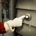 Santa is ringing a door bell to give surprise Stock Photos