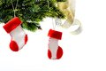 Santa s boots on christmas tree Royalty Free Stock Photography
