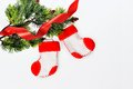 Santa s boots on christmas tree and red ribbon Stock Image