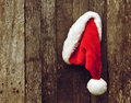 Santa's hat on wood. Stock Photos