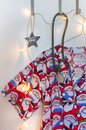 Santa scrubs, stethoscope, Christmas star and lights Royalty Free Stock Photo