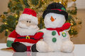 Santa & Snowman Stuffed Toys Royalty Free Stock Photo