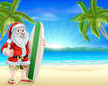 Santa surfer on tropical beach Royalty Free Stock Photo