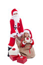 Santa with surprise present Royalty Free Stock Photo