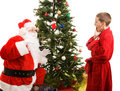 Santa Surprised by Child Royalty Free Stock Photo