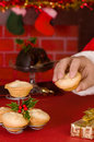 Santa Takes A Mince Pie Royalty Free Stock Photos