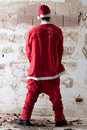Santa Urinating on a Wall Stock Images